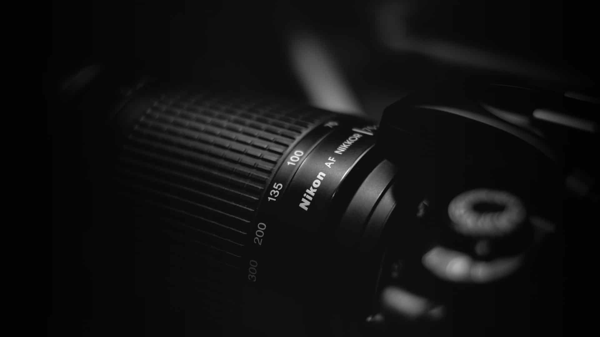 Best Nikon Camera Lenses - Header - StudioBinder