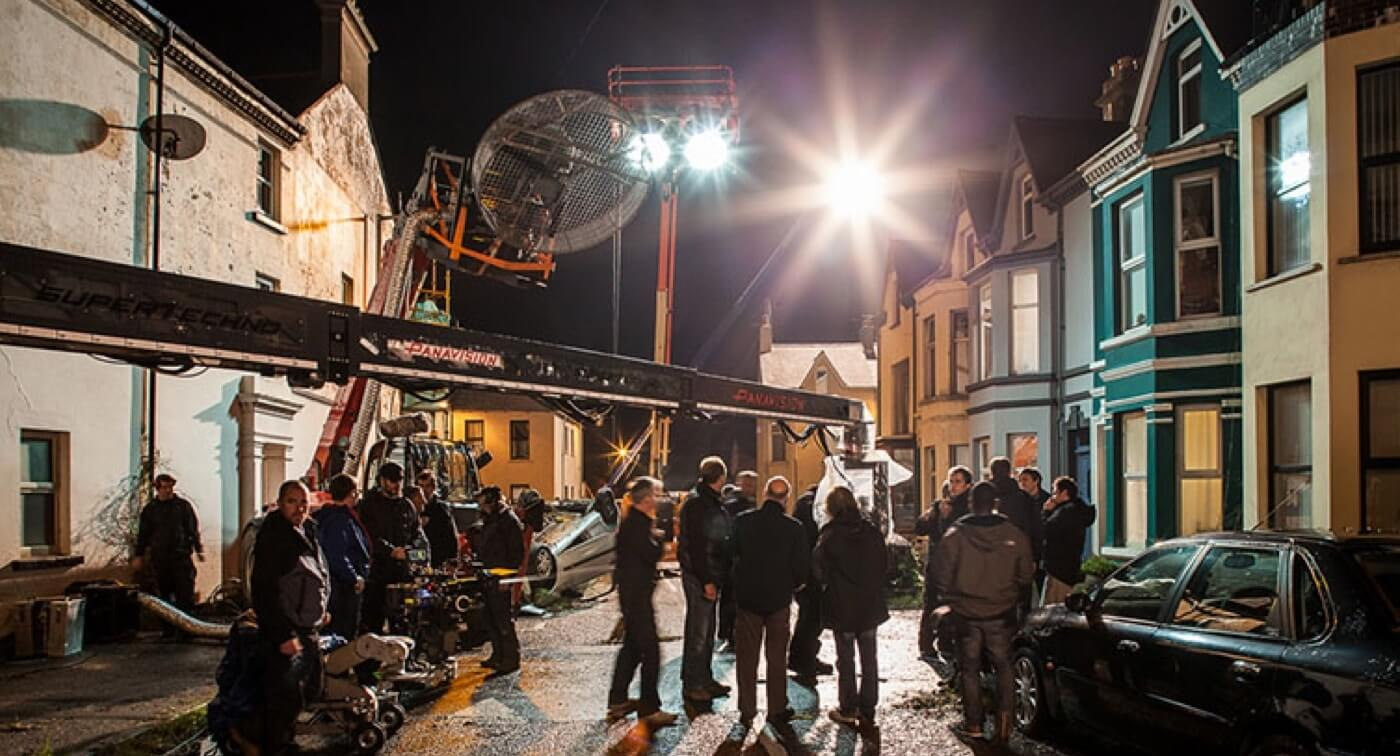 10 Shooting Schedule Pro Tips to Build Momentum on Set - 10 - Night Scene Film Crew - StudioBinder