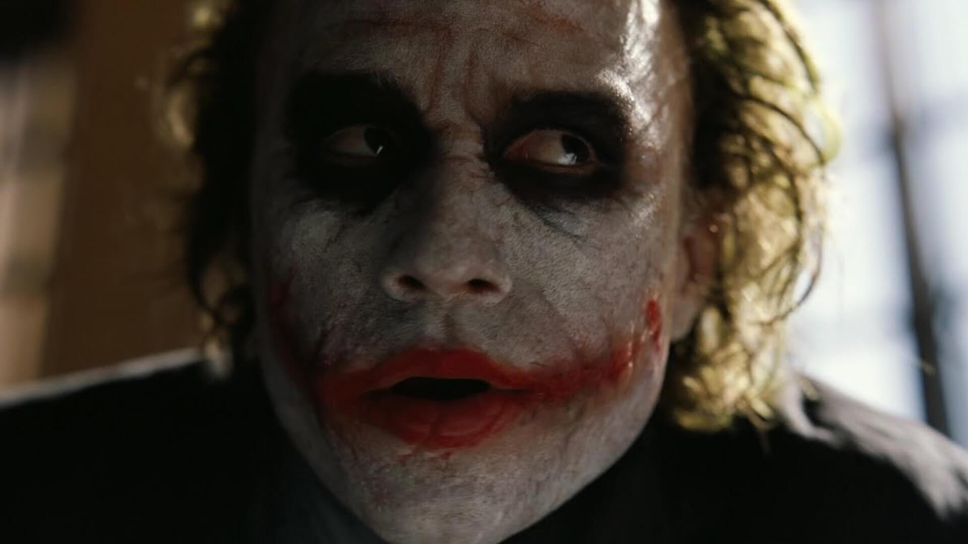 How to Design Shot Lists Like Christopher Nolan - Closeup Joker Dark Knight - StudioBinder