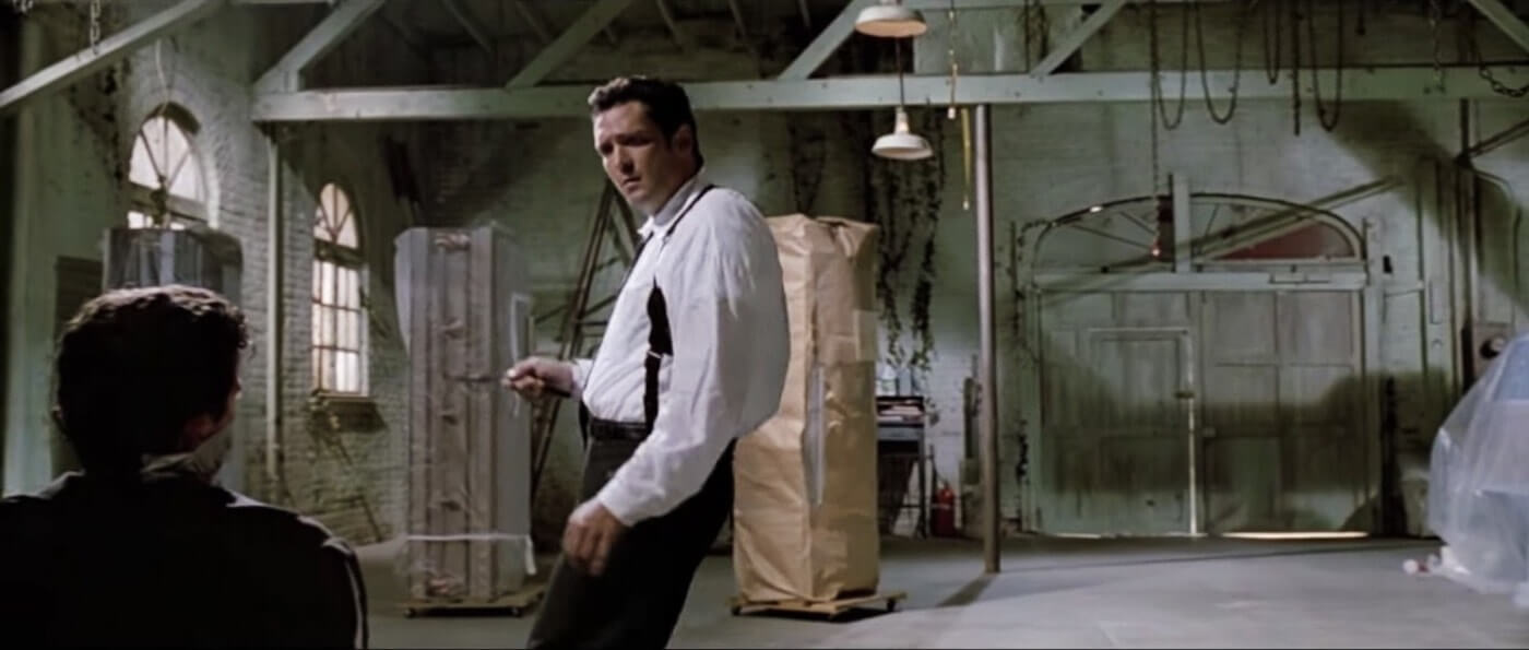 Ultimate Guide To Camera Shots - Michael Madsen Framed In A Hip Level Over The Shoulder Shot For Reservoir Dogs