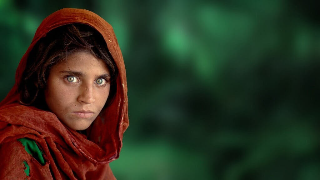 Focus on the eyes to take good portrait shots — Portrait by Steve McCurry