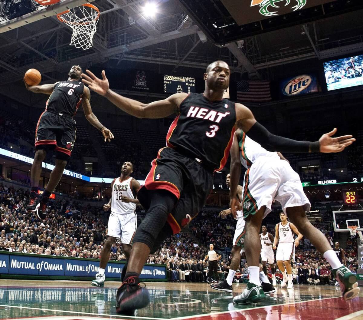 Best Lens for Sports Photography Pictures - LeBron James Rises Up for a Dunk - Morry Gash, AP