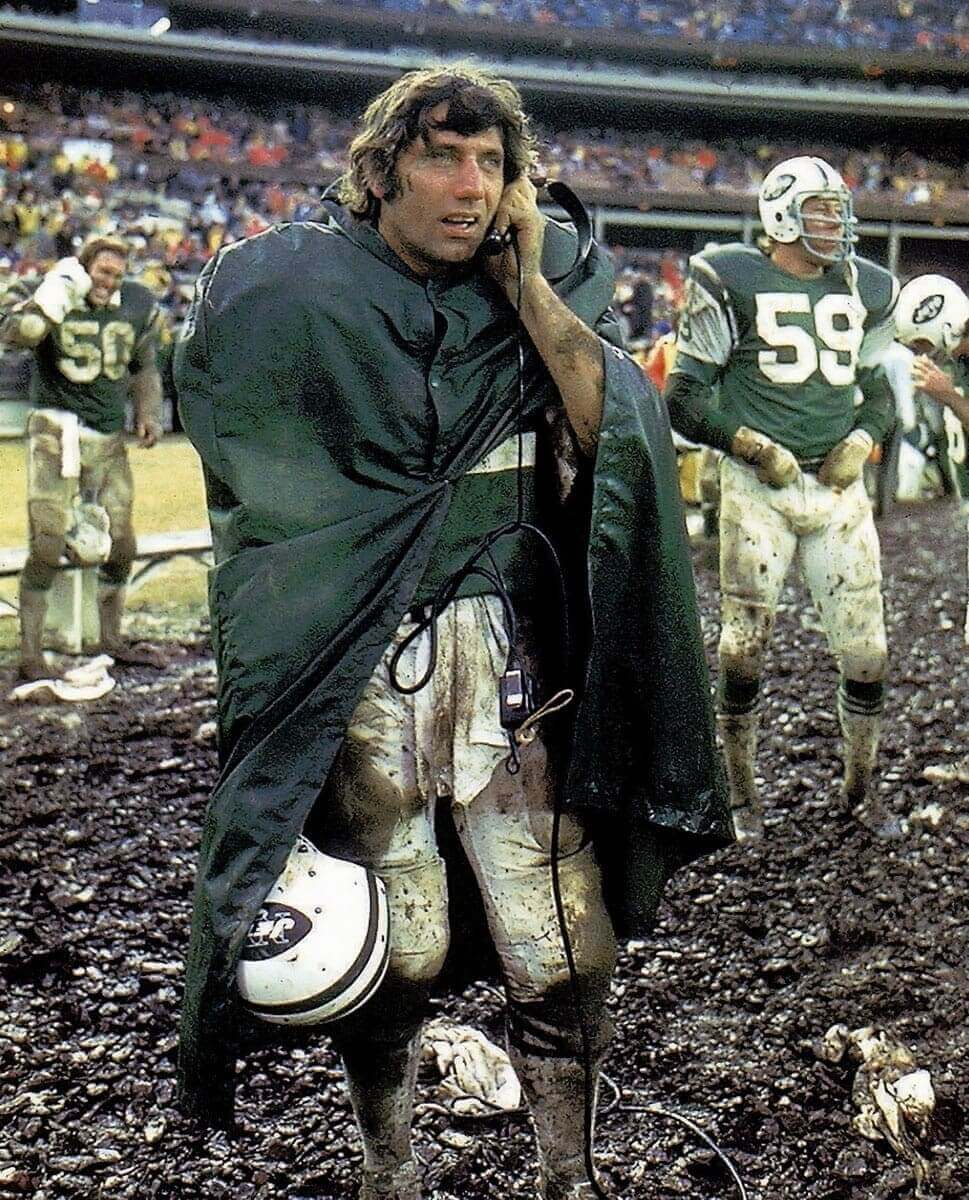 Sports Photography Photos - Joe Namath Takes a Call at a Messy Jets Game - Neil Leifer